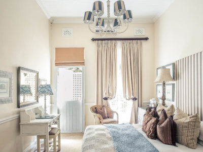 gallery-goble-palms-guest-lodge-urban-retreat-accommodation-main-building-contemporary-colonial-comfort-bed-breakfast-bedroom-mirror-upper-morningside-kzn